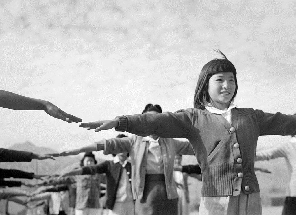 Female interns practicing calisthenics at Manzanar internment camp, 1943