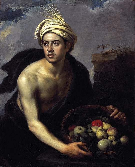 Young man with basket of fruit