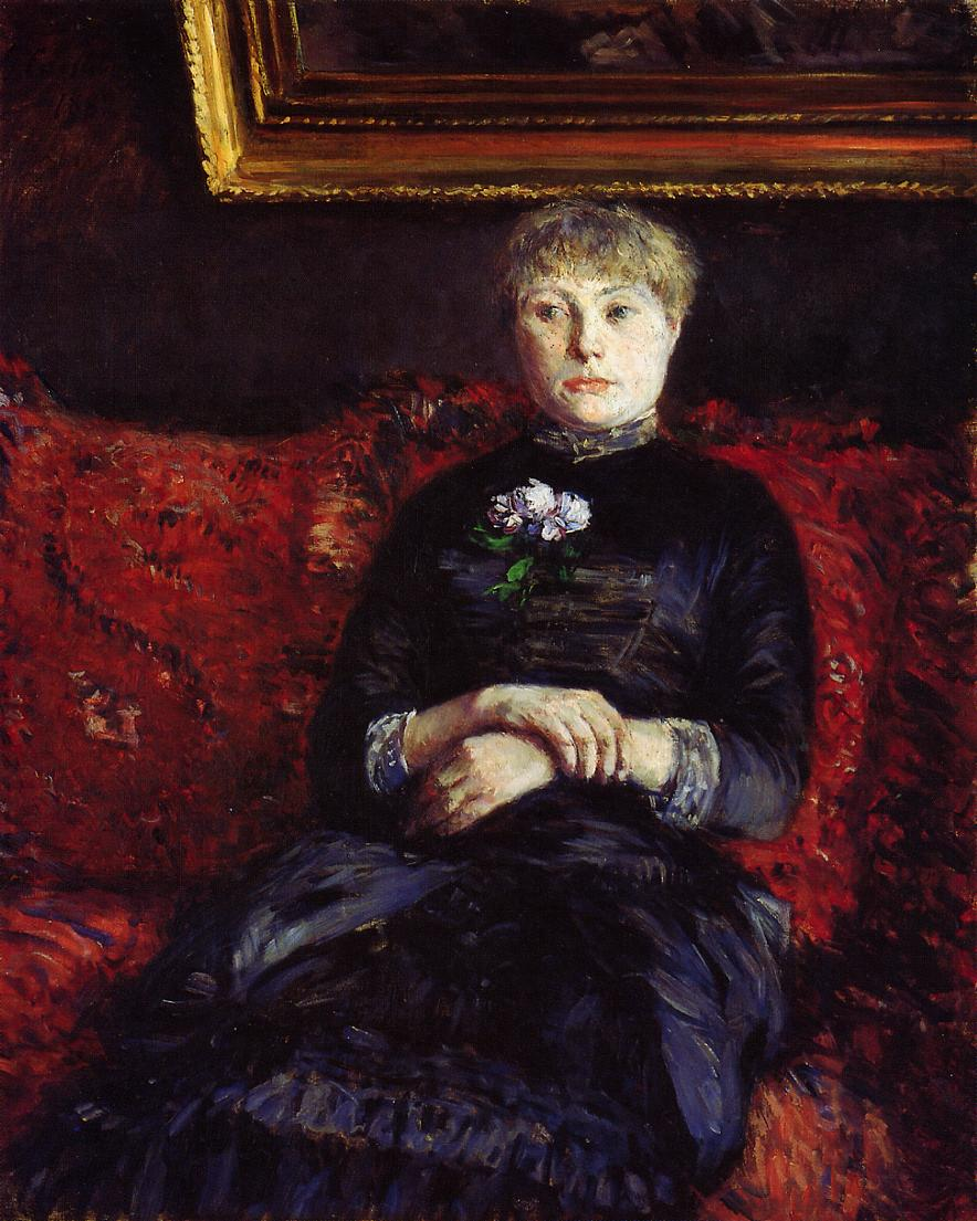Woman Sitting on a Red Flowered Sofa, 1882